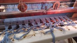 Transferring from roller to loom